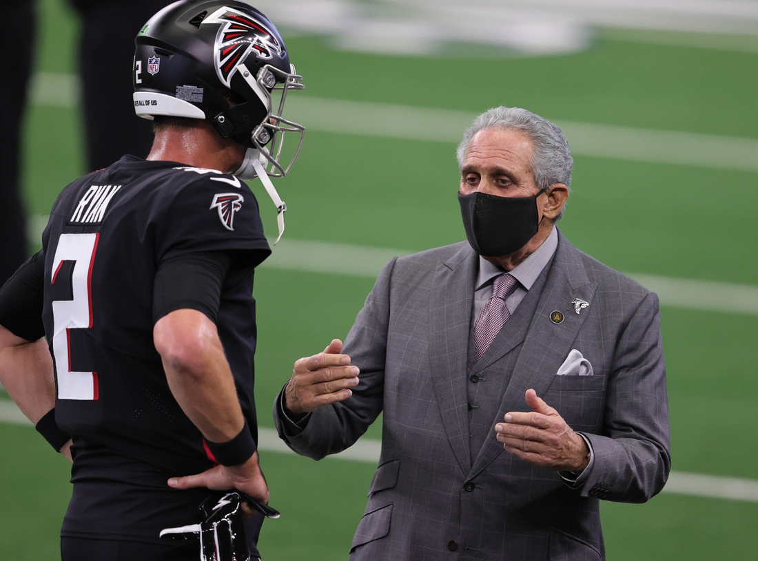 Sep 20, 2020; Arlington, Texas, USA; Atlanta Falcons quarterback Matt Ryan (2) talks with owner Arthur Blank prior to the game against the Dallas Cowboys at AT&T Stadium. Mandatory Credit: Matthew Emmons-USA TODAY Sports