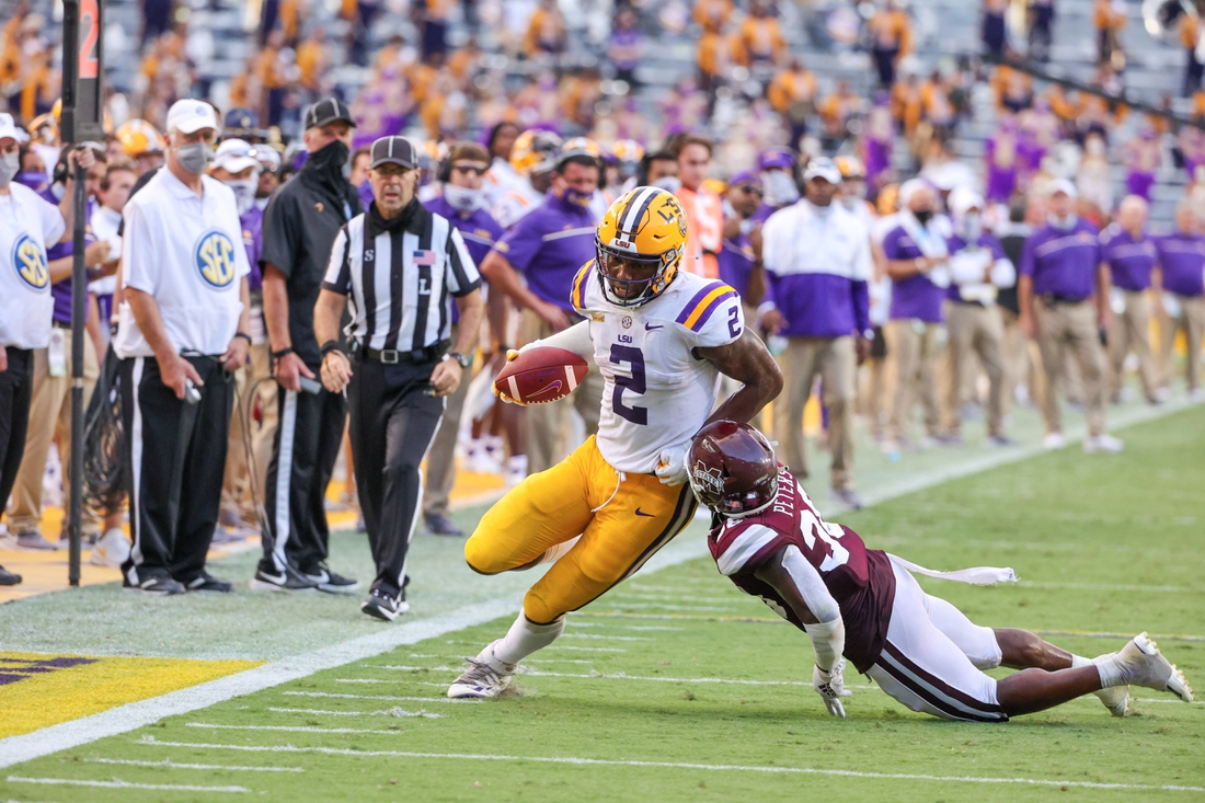 Sep 26, 2020; Baton Rouge, Louisiana, USA; LSU Tigers tight end Arik Gilbert (2) is tacled by Mississippi State Bulldogs safety Fred Peters (38) during the second half at Tiger Stadium. Mandatory Credit: Derick E. Hingle-USA TODAY Sports