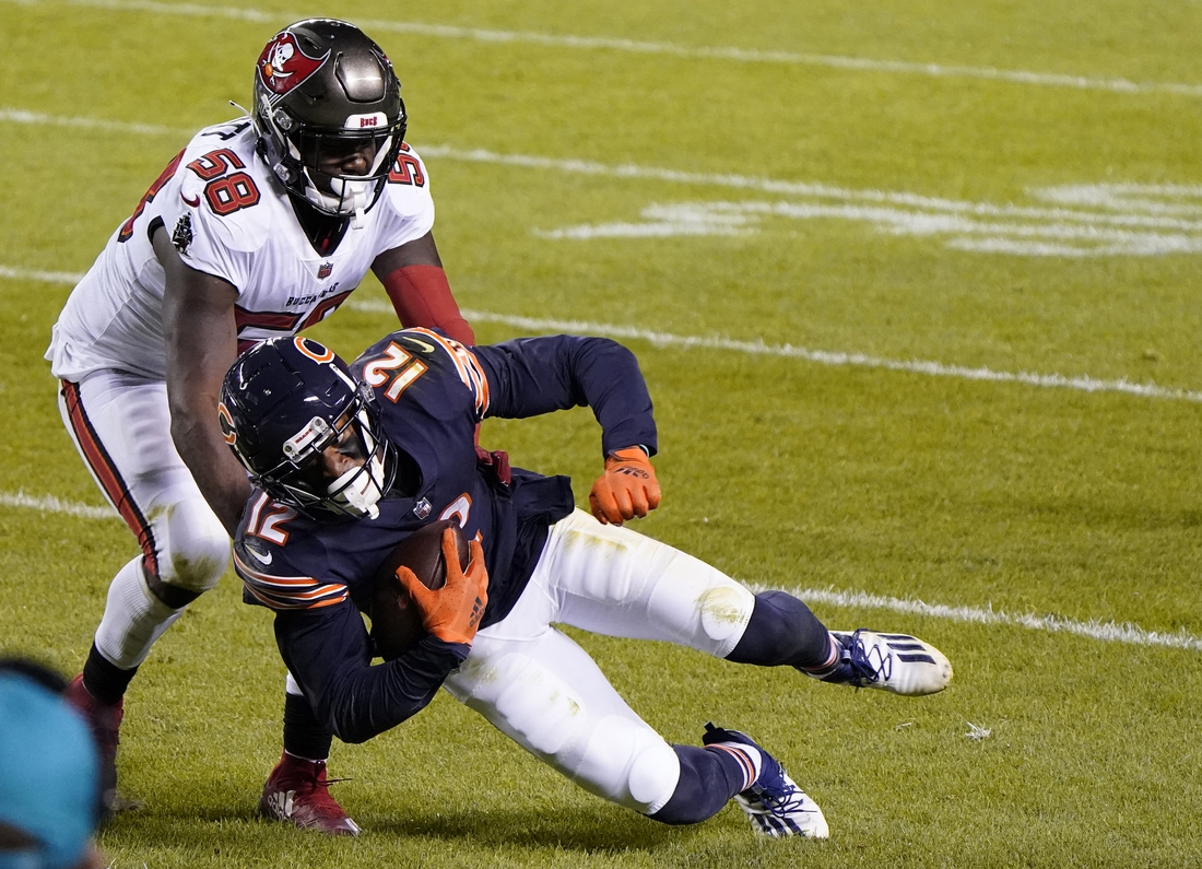 Oct 8, 2020; Chicago, Illinois, USA; Tampa Bay Buccaneers outside linebacker Shaquil Barrett (58) makes a tackle on Chicago Bears wide receiver Allen Robinson (12) during the fourth quarter at Soldier Field. Mandatory Credit: Mike Dinovo-USA TODAY Sports