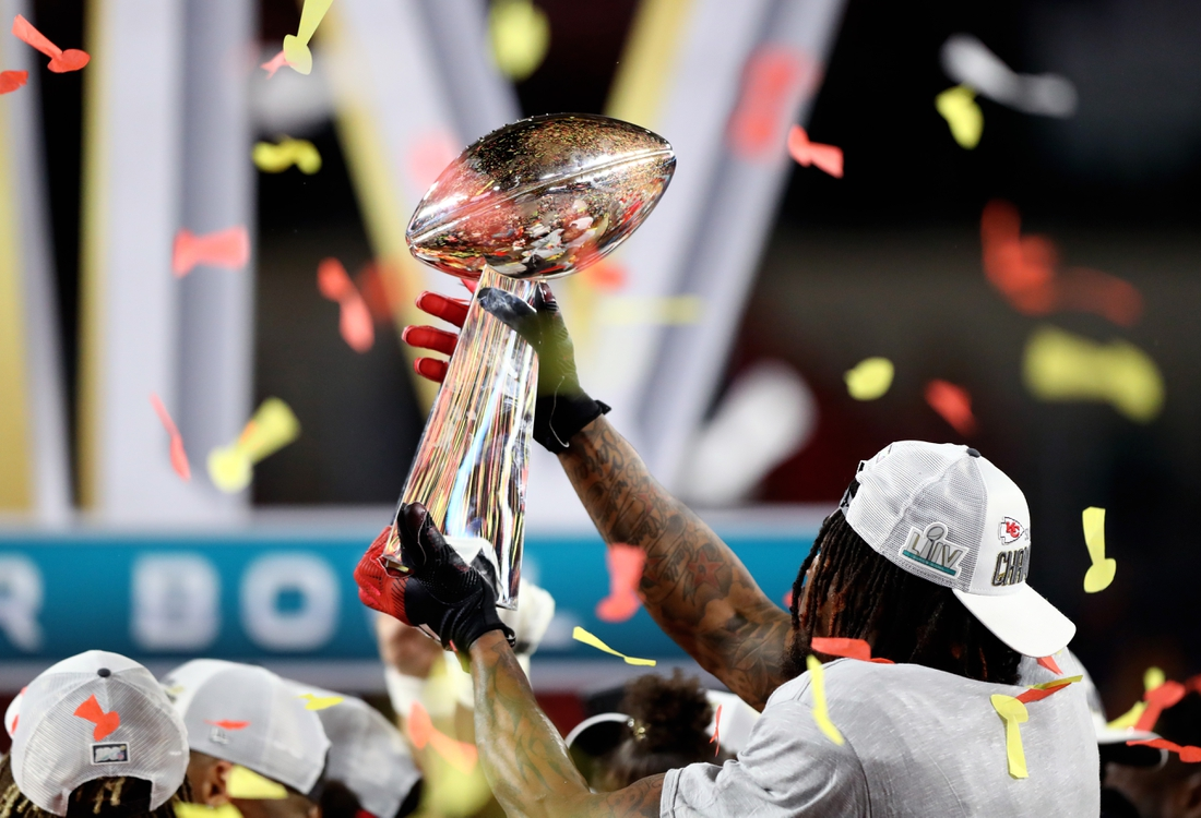 Feb 2, 2020; Miami Gardens, Florida, USA; Detailed view of the Vince Lombardi Trophy in the hands of a Kansas City Chiefs player celebrating after defeating the San Francisco 49ers in Super Bowl LIV at Hard Rock Stadium. Mandatory Credit: Mark J. Rebilas-USA TODAY Sports