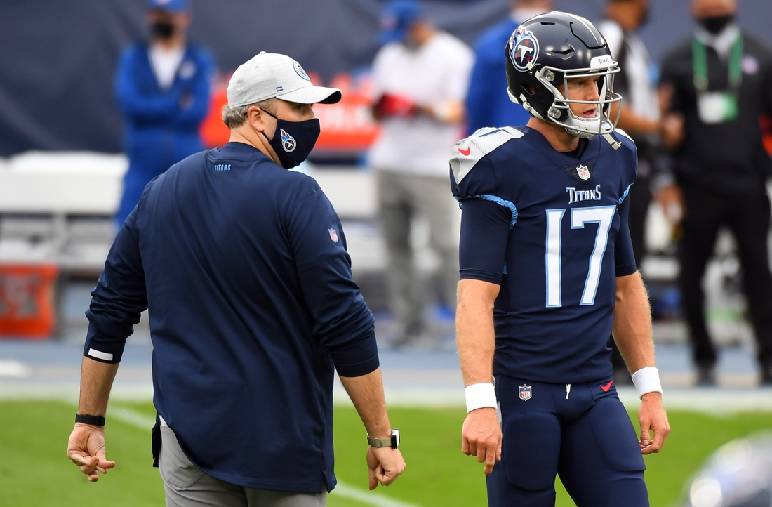 Oct 18, 2020; Nashville, Tennessee, USA; Tennessee Titans offensive coordinator Arthur Smith talks with quarterback Ryan Tannehill (17) before a game against the Houston Texans at Nissan Stadium. Mandatory Credit: Christopher Hanewinckel-USA TODAY Sports