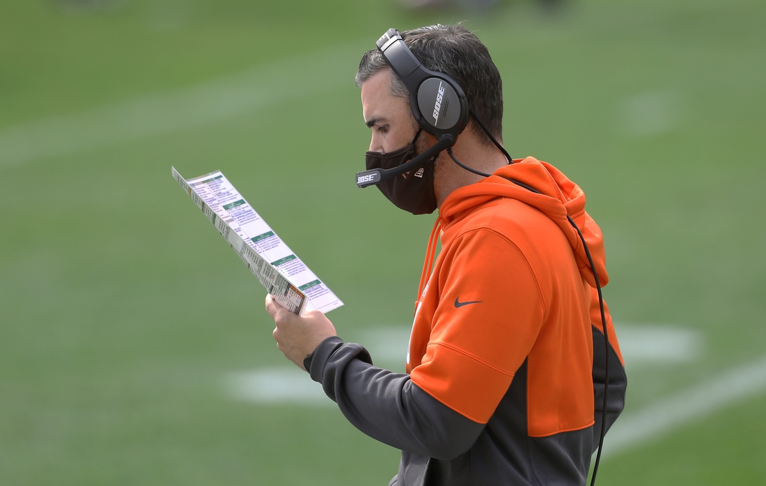 Oct 18, 2020; Pittsburgh, Pennsylvania, USA;  Cleveland Browns head coach Kevin Stefanski looks at his play chart a during the second quarter gainst the Pittsburgh Steelers at Heinz Field. Mandatory Credit: Charles LeClaire-USA TODAY Sports