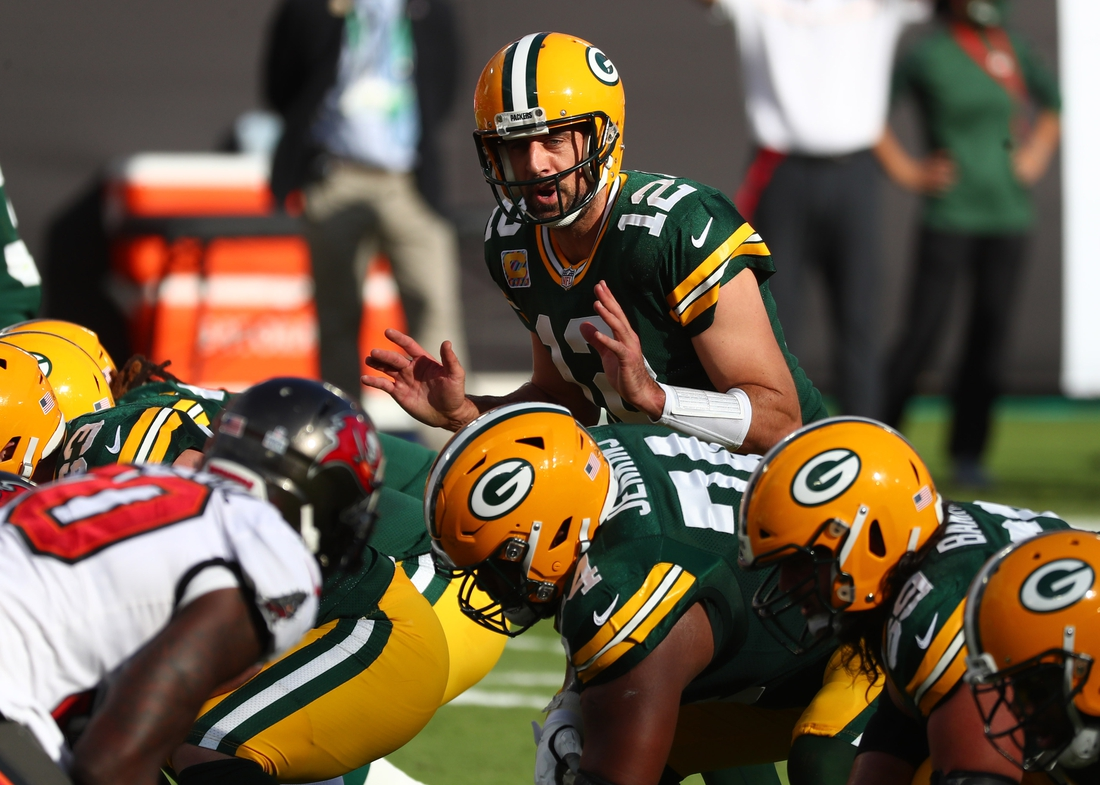 Oct 18, 2020; Tampa, Florida, USA; Green Bay Packers quarterback Aaron Rodgers (12) calls a play against the Tampa Bay Buccaneers during the first quarter of a NFL game at Raymond James Stadium. Mandatory Credit: Kim Klement-USA TODAY Sports