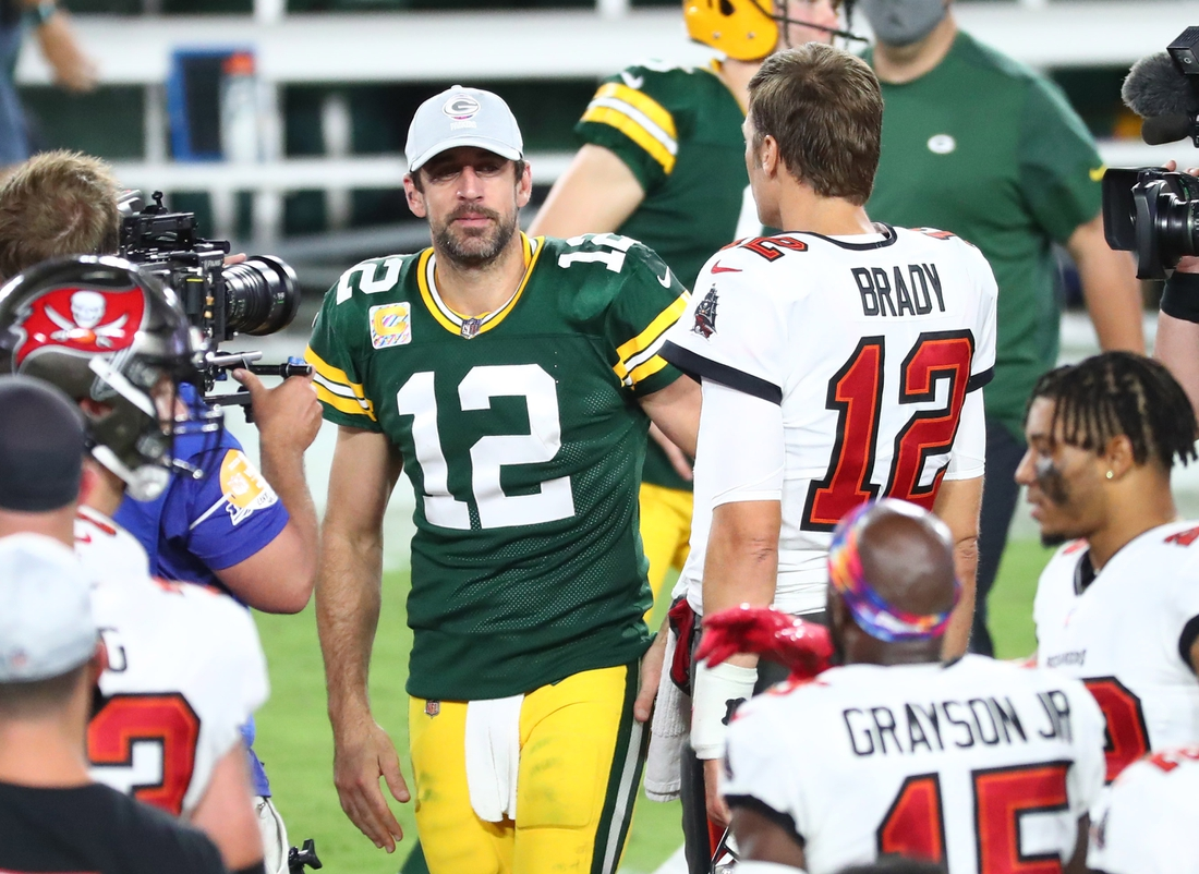 Oct 18, 2020; Tampa, Florida, USA; Tampa Bay Buccaneers quarterback Tom Brady (right) greets Green Bay Packers quarterback Aaron Rodgers (left) after a NFL game at Raymond James Stadium. Mandatory Credit: Kim Klement-USA TODAY Sports