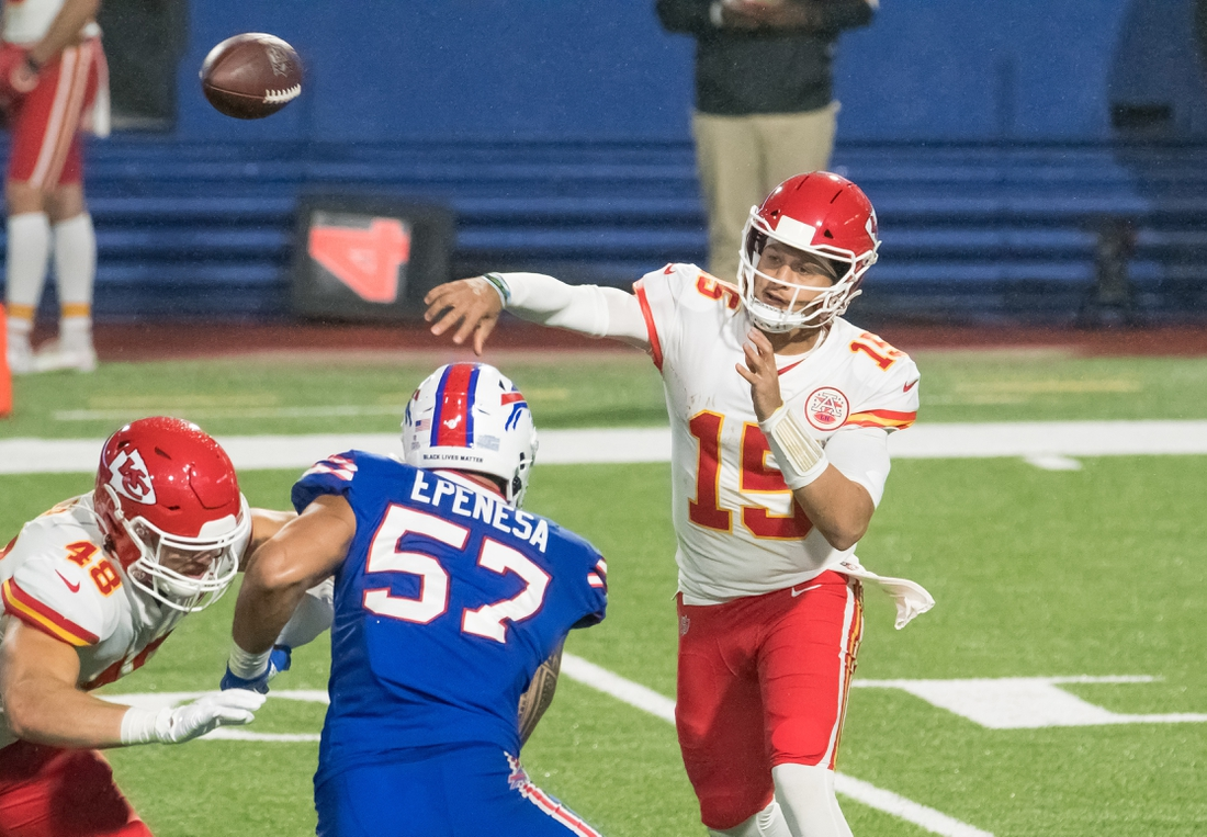 Oct 19, 2020; Orchard Park, New York, USA; Kansas City Chiefs quarterback Patrick Mahomes (15) throws a pass as tight end Nick Keizer (48) blocks Buffalo Bills defensive end A.J. Epenesa (57) in the third quarter at Bills Stadium. Mandatory Credit: Mark Konezny-USA TODAY Sports