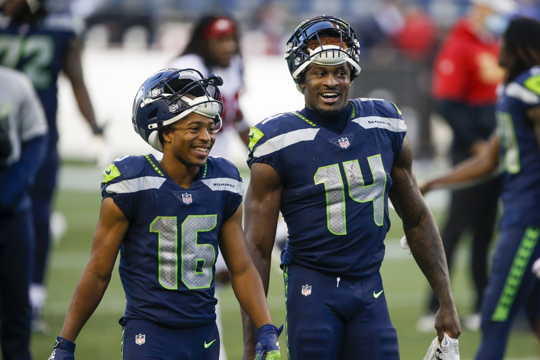 Nov 1, 2020; Seattle, Washington, USA; Seattle Seahawks wide receiver Tyler Lockett (16) and wide receiver DK Metcalf (14) return to the locker room following a 37-27 victory against the San Francisco 49ers at CenturyLink Field. Mandatory Credit: Joe Nicholson-USA TODAY Sports