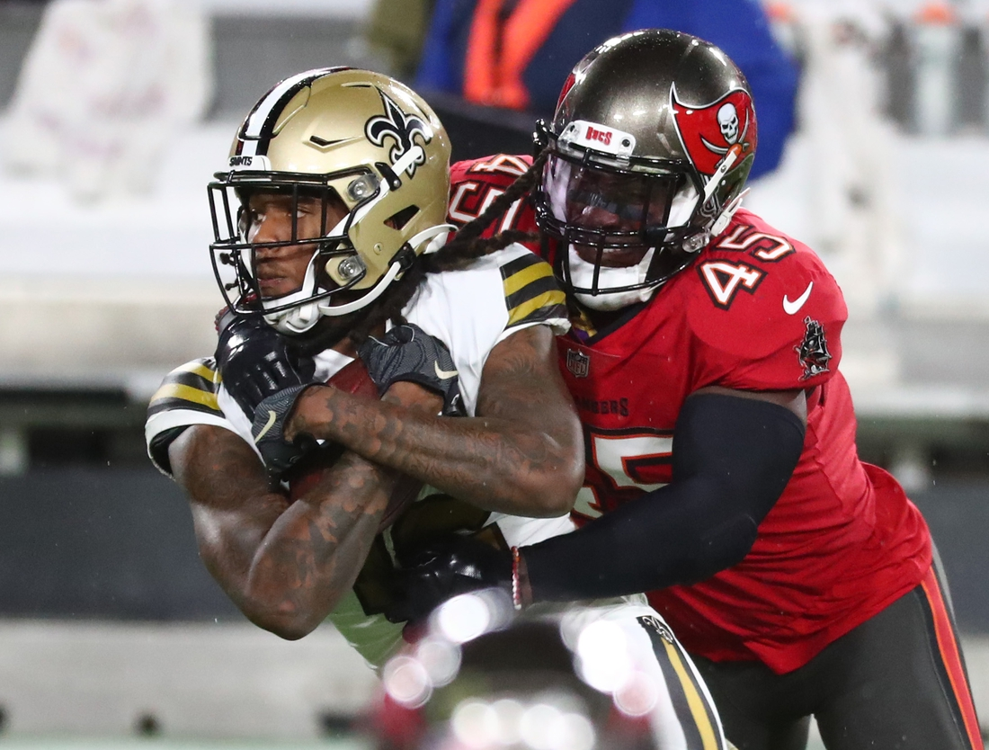 Nov 8, 2020; Tampa, Florida, USA; New Orleans Saints wide receiver Marquez Callaway (12) is tackled by inside linebacker Devin White (45) defends in the first quarter of a NFL game at Raymond James Stadium. Mandatory Credit: Kim Klement-USA TODAY Sports
