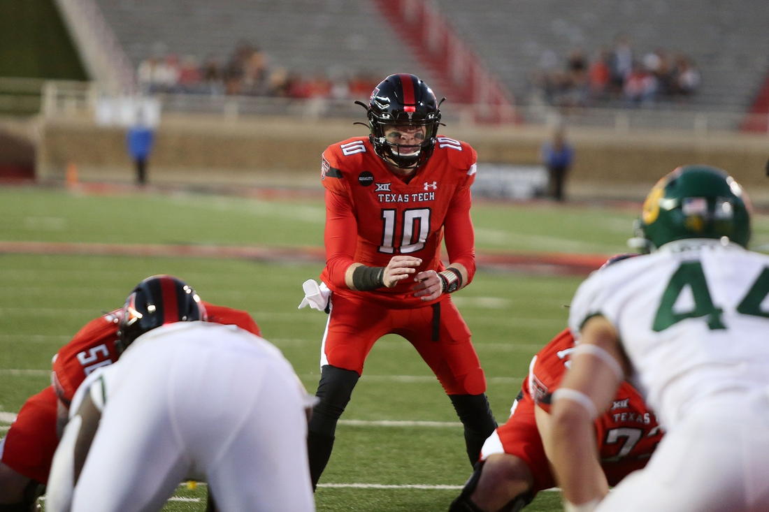 Nov 14, 2020; Lubbock, Texas, USA;  Texas Tech Red Raiders quarterback Alan Bowman (10) calls signals in the second half in the game against the Baylor Bears at Jones AT&T Stadium. Mandatory Credit: Michael C. Johnson-USA TODAY Sports