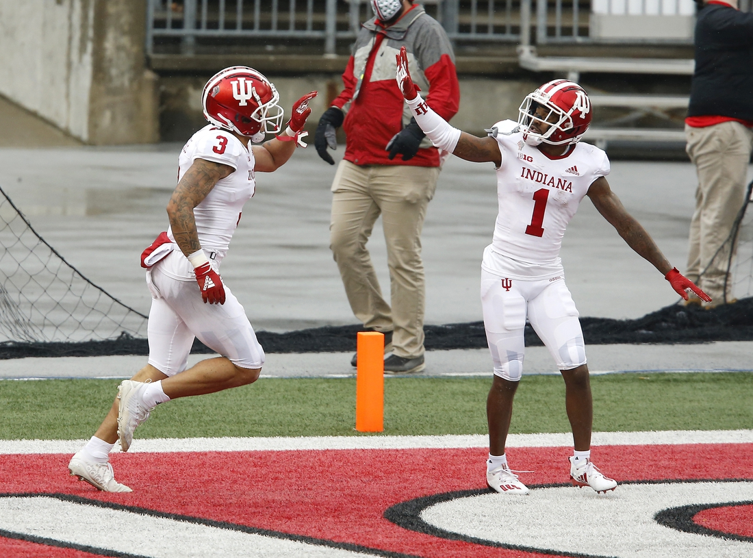 Nov 21, 2020; Columbus, Ohio, USA; Indiana Hoosiers wide receiver Ty Fryfogle (3) celebrates his touchdown with wide receiver Whop Philyor (1) during the third quarter against the Ohio State Buckeyes at Ohio Stadium. Mandatory Credit: Joseph Maiorana-USA TODAY Sports