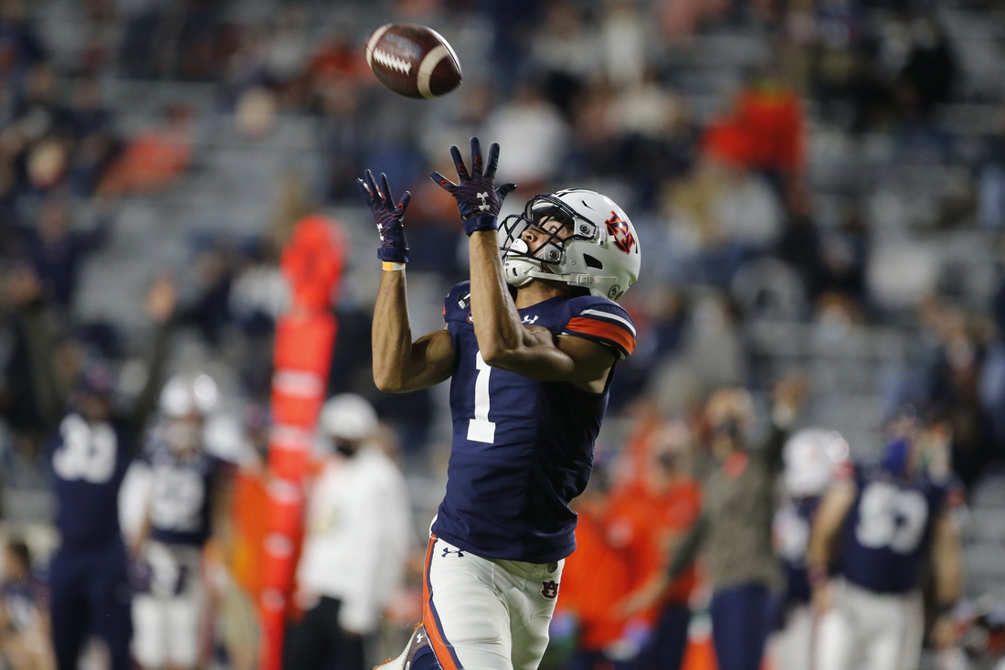 Nov 21, 2020; Auburn, Alabama, USA;  Auburn Tigers receiver Anthony Schwartz (1) makes a touchdown catch against the Tennessee Volunteers during the second quarter at Jordan-Hare Stadium. Mandatory Credit: John Reed-USA TODAY Sports