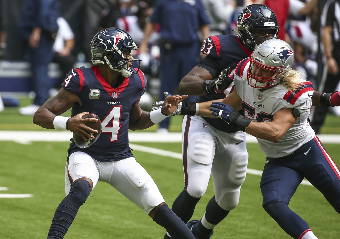 Nov 22, 2020; Houston, Texas, USA; Houston Texans quarterback Deshaun Watson (4) scrambles with the ball as New England Patriots defensive end Chase Winovich (50) applies defensive pressure during the second quarter at NRG Stadium. Mandatory Credit: Troy Taormina-USA TODAY Sports