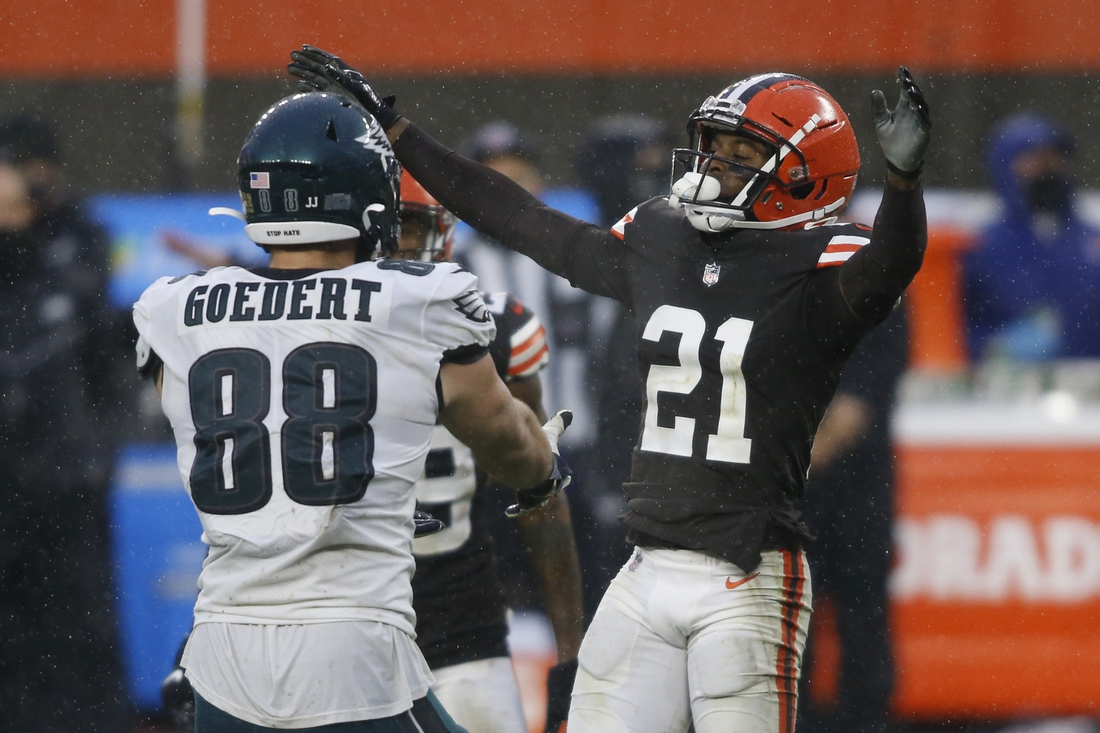 Nov 22, 2020; Cleveland, Ohio, USA; Cleveland Browns cornerback Denzel Ward (21) reacts after a pass play to Philadelphia Eagles tight end Dallas Goedert (88) during the second half at FirstEnergy Stadium. Mandatory Credit: Scott Galvin-USA TODAY Sports