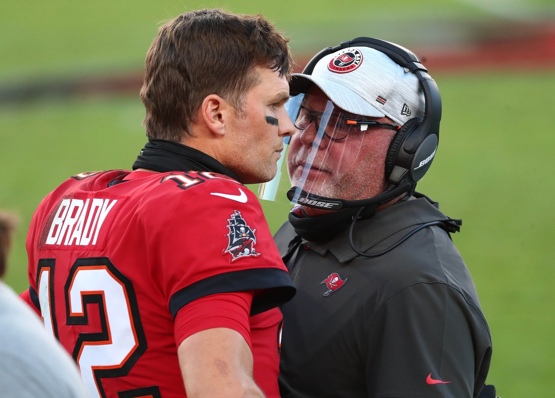 Nov 29, 2020; Tampa, Florida, USA; Tampa Bay Buccaneers head coach Bruce Arians speaks with Tampa Bay Buccaneers quarterback Tom Brady (12) during the first half at Raymond James Stadium. Mandatory Credit: Kim Klement-USA TODAY Sports
