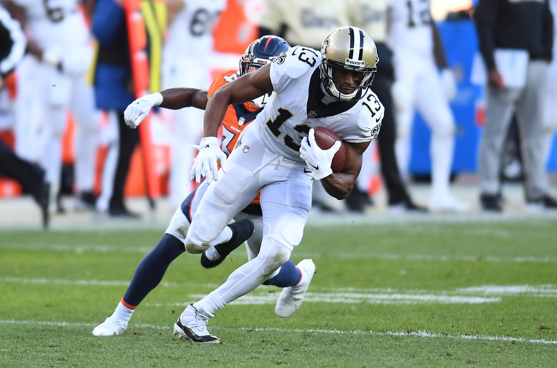 Nov 29, 2020; Denver, Colorado, USA; New Orleans Saints wide receiver Michael Thomas (13) carries the ball against the Denver Broncos in the second quarter at Empower Field at Mile High. Mandatory Credit: Ron Chenoy-USA TODAY Sports
