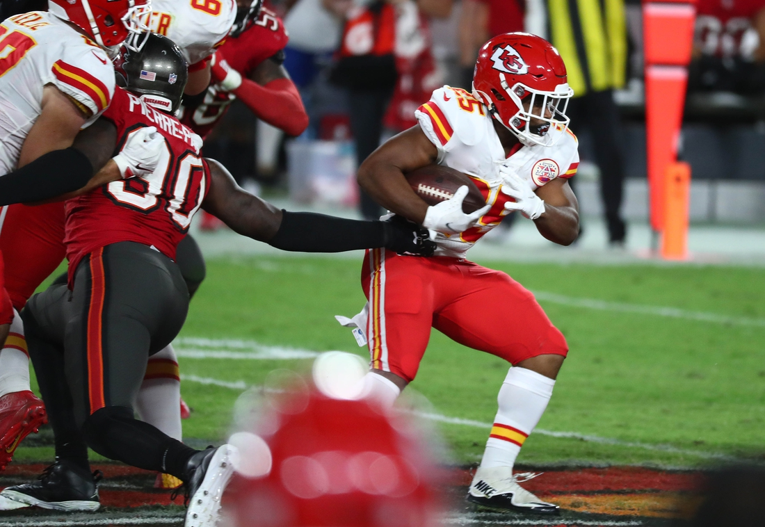 Nov 29, 2020; Tampa, Florida, USA; Kansas City Chiefs running back Clyde Edwards-Helaire (25) runs the ball against Tampa Bay Buccaneers defensive tackle Khalil Davis (94) during the second half at Raymond James Stadium. Mandatory Credit: Kim Klement-USA TODAY Sports