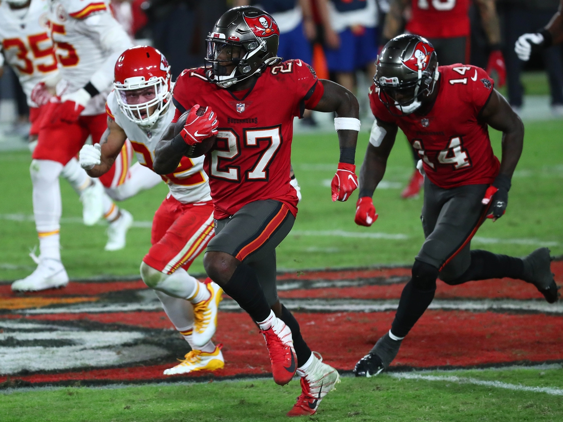 Nov 29, 2020; Tampa, Florida, USA; Tampa Bay Buccaneers running back Ronald Jones (27) runs the ball against the Kansas City Chiefs during the second half at Raymond James Stadium. Mandatory Credit: Kim Klement-USA TODAY Sports