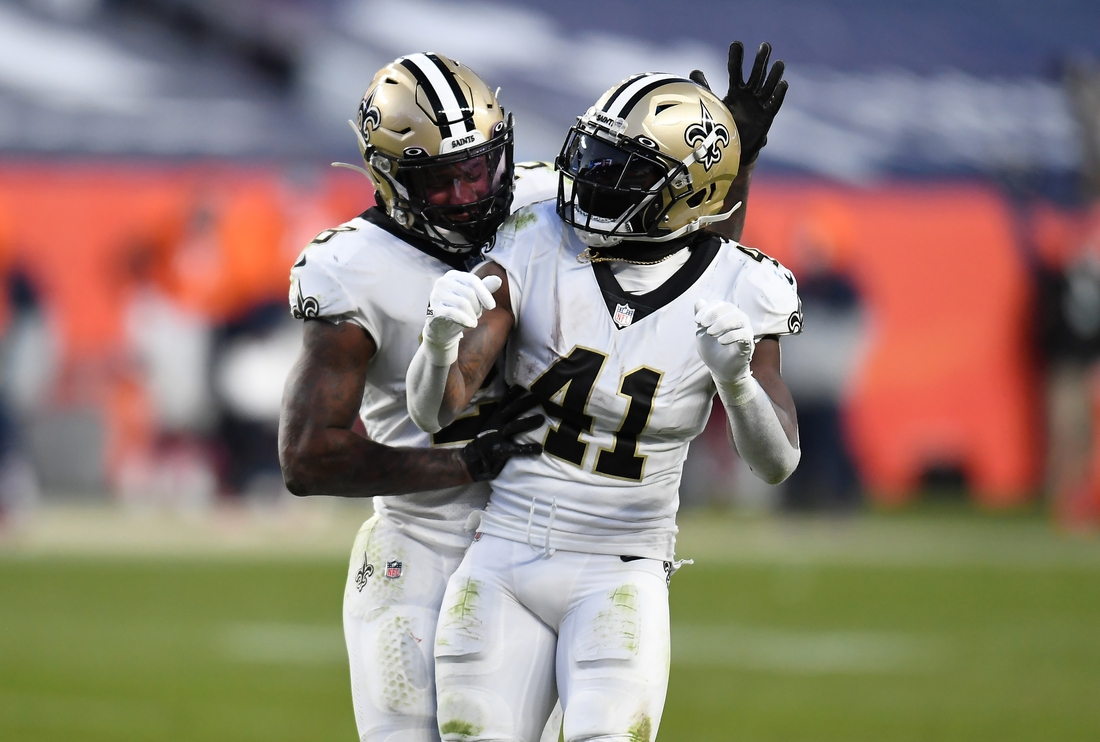 Nov 29, 2020; Denver, Colorado, USA; New Orleans Saints running back Latavius Murray (28) celebrates his touchdown with running back Alvin Kamara (41) in the fourth quarter against the Denver Broncosat Empower Field at Mile High. Mandatory Credit: Ron Chenoy-USA TODAY Sports
