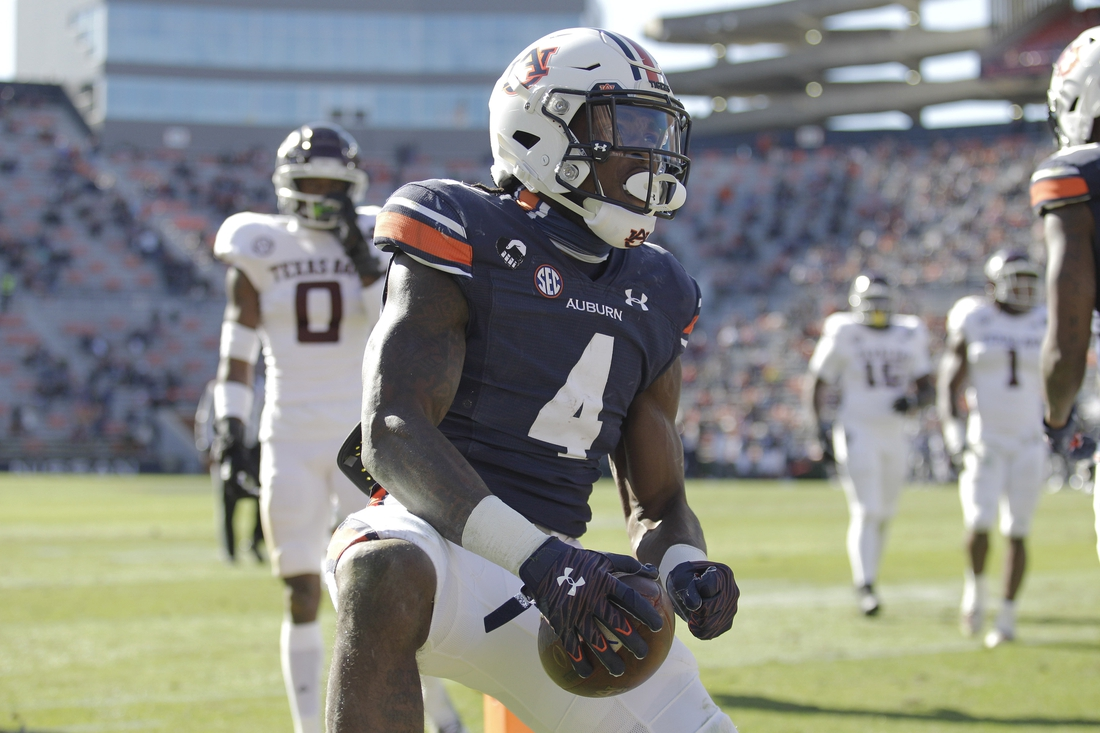 Dec 5, 2020; Auburn, Alabama, USA;  Auburn Tigers running back Tank Bigsby (4) reacts after a long run agains the Texas A&M Aggies during the third quarter at Jordan-Hare Stadium. Mandatory Credit: John Reed-USA TODAY Sports