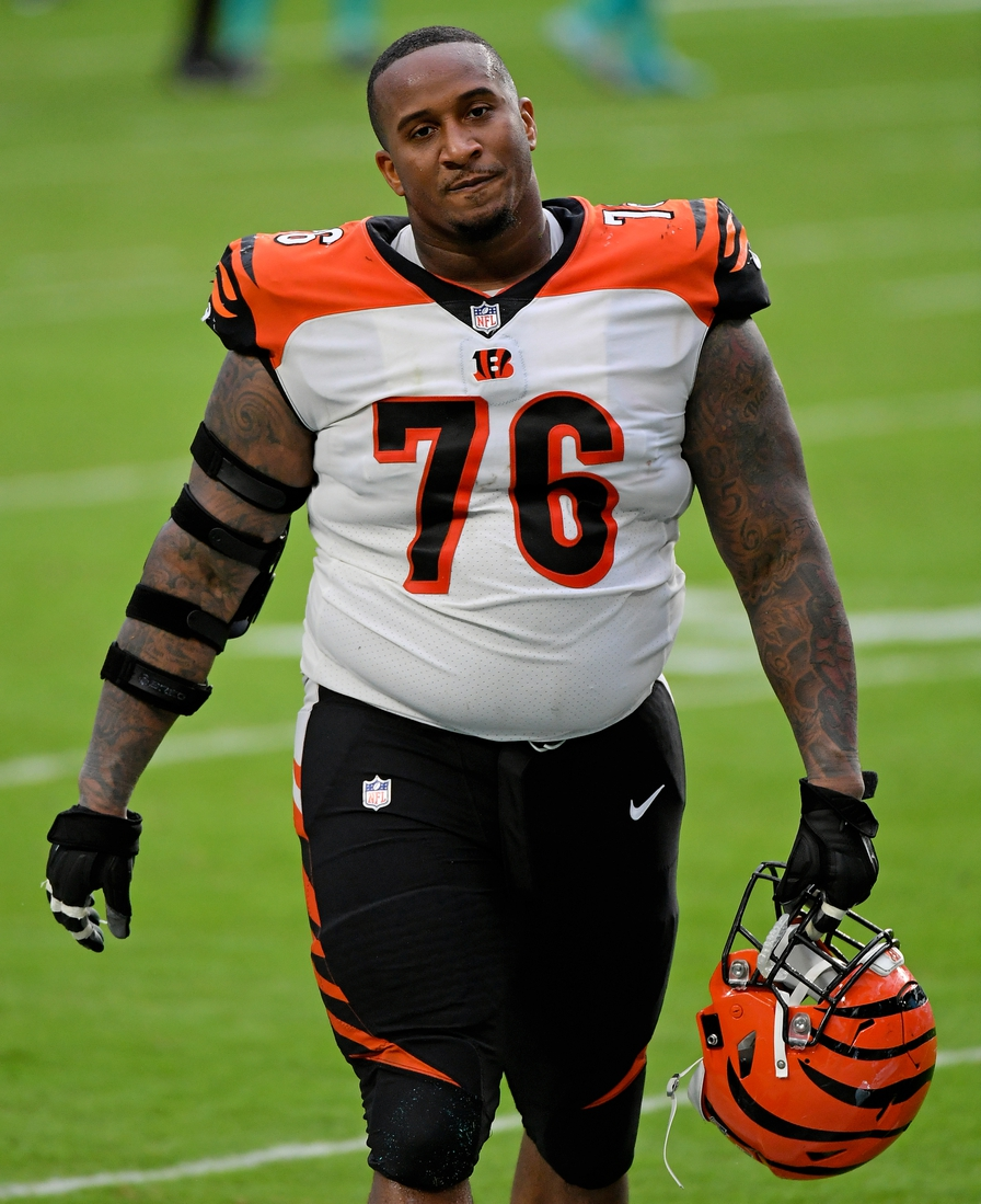 Dec 6, 2020; Miami Gardens, Florida, USA; Cincinnati Bengals defensive tackle Mike Daniels (76) walks off the field after the game against the Miami Dolphins at Hard Rock Stadium. Mandatory Credit: Jasen Vinlove-USA TODAY Sports