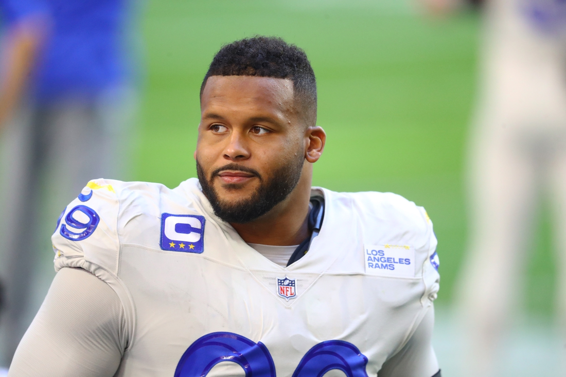 Dec 6, 2020; Glendale, Arizona, USA; Los Angeles Rams defensive tackle Aaron Donald (99) against the Arizona Cardinals at State Farm Stadium. Mandatory Credit: Mark J. Rebilas-USA TODAY Sports