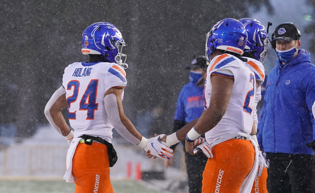 Dec 12, 2020; Laramie, Wyoming, USA; Boise State Broncos running back George Holani (24) celebrates a touchdown against the Wyoming Cowboys during the first quarter at Jonah Field at War Memorial Stadium. Mandatory Credit: Troy Babbitt-USA TODAY Sports