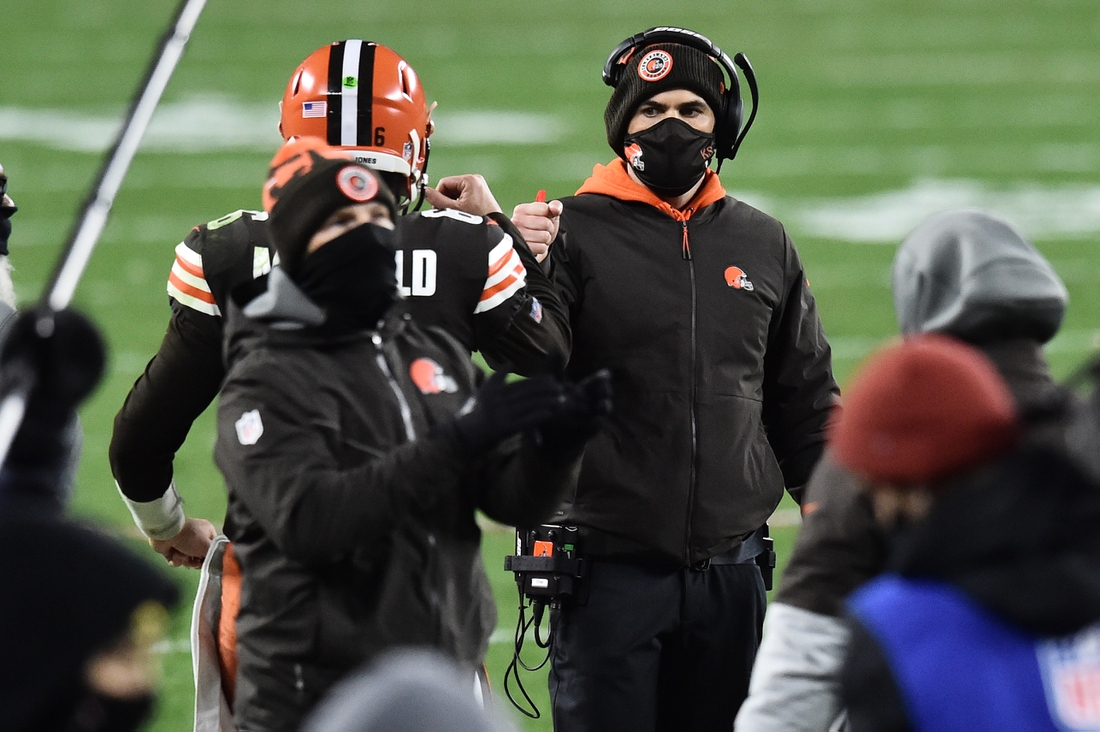 Dec 14, 2020; Cleveland, Ohio, USA; Cleveland Browns quarterback Baker Mayfield (6) celebrate with head coach Kevin Stefanski after Mayfield scored a touchdown during the second half against the Baltimore Ravens at FirstEnergy Stadium. Mandatory Credit: Ken Blaze-USA TODAY Sports
