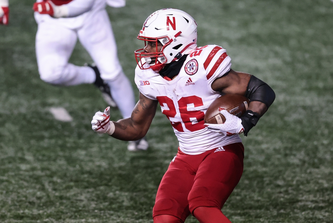 Dec 18, 2020; Piscataway, New Jersey, USA; Nebraska Cornhuskers running back Dedrick Mills (26) carries the ball  during the second half against the Rutgers Scarlet Knights at SHI Stadium. Mandatory Credit: Vincent Carchietta-USA TODAY Sports