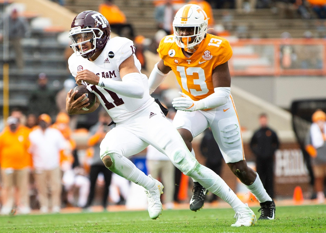 Dec 19, 2020; Knoxville, TN, USA; Tennessee linebacker Deandre Johnson (13) chases down Texas A&M quarterback Kellen Mond (11) during a SEC game between the Tennessee Volunteers and the Texas A&M Aggies held at Neyland Stadium in Knoxville, Tenn., on Saturday, December 19, 2020. Mandatory Credit: Brianna Paciorka-USA TODAY NETWORK
