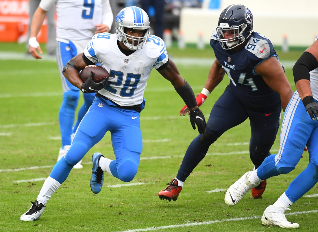 Dec 20, 2020; Nashville, Tennessee, USA; Detroit Lions running back Adrian Peterson (28) runs for a short gain against the Tennessee Titans during the first half at Nissan Stadium. Mandatory Credit: Christopher Hanewinckel-USA TODAY Sports