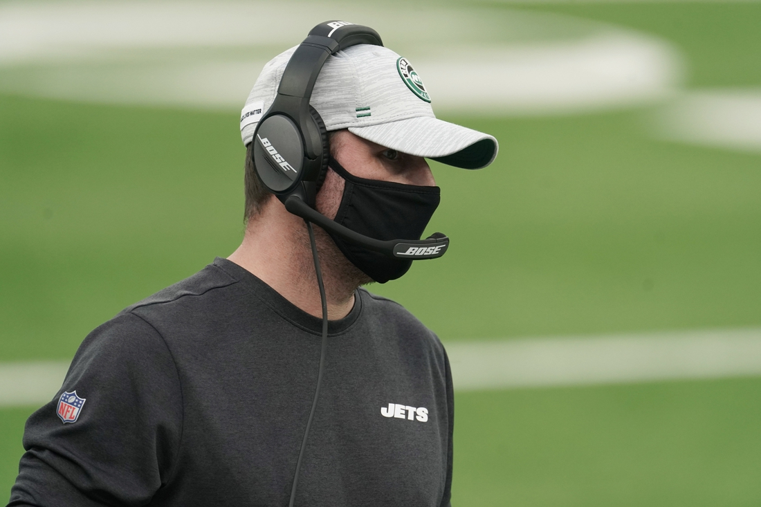 Dec 20, 2020; Inglewood, California, USA; New York Jets head coach Adam Gase wears a face mask on the sidelines in the first half against the Los Angeles Rams at SoFi Stadium. The Jets defeated the Rams 23-20. Mandatory Credit: Kirby Lee-USA TODAY Sports