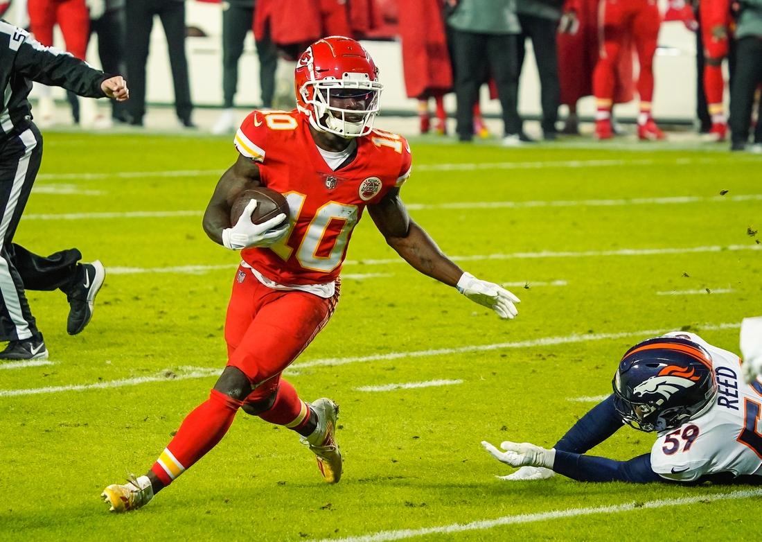 Dec 6, 2020; Kansas City, Missouri, USA; Kansas City Chiefs wide receiver Tyreek Hill (10) runs against Denver Broncos linebacker Malik Reed (59) during the first half at Arrowhead Stadium. Mandatory Credit: Jay Biggerstaff-USA TODAY Sports