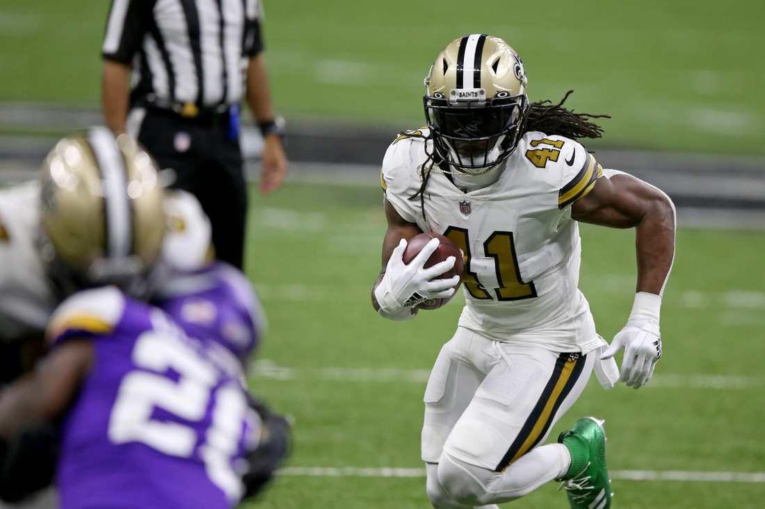 Dec 25, 2020; New Orleans, Louisiana, USA; New Orleans Saints running back Alvin Kamara (41) runs against the Minnesota Vikings in the second quarter at the Mercedes-Benz Superdome. Mandatory Credit: Chuck Cook-USA TODAY Sports