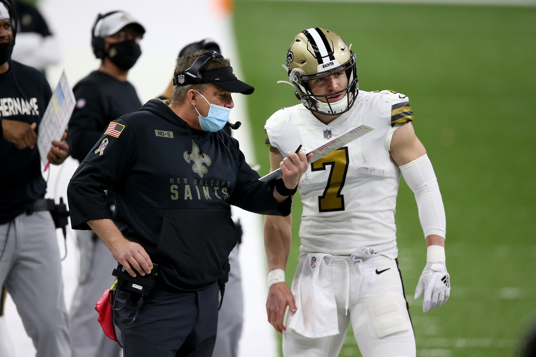 Dec 25, 2020; New Orleans, Louisiana, USA; New Orleans Saints head coach Sean Payton talks to quarterback Taysom Hill (7) in the second quarter against the Minnesota Vikings at the Mercedes-Benz Superdome. Mandatory Credit: Chuck Cook-USA TODAY Sports
