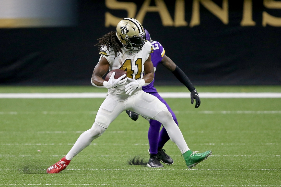 Dec 25, 2020; New Orleans, Louisiana, USA; New Orleans Saints running back Alvin Kamara (41) is defended by Minnesota Vikings cornerback Jeff Gladney (20) in the second half at the Mercedes-Benz Superdome. Mandatory Credit: Chuck Cook-USA TODAY Sports