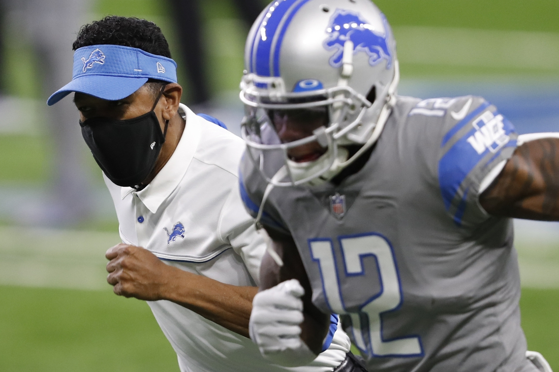 Dec 26, 2020; Detroit, Michigan, USA; Detroit Lions acting head coach Robert Prince sprints down the field with wide receiver Mohamed Sanu (12) before a game against the Tampa Bay Buccaneers at Ford Field. Prince assumed the head coaching duties for the game after Lions interim head coach Darrell Bevell was deemed a high-risk close contact to a confirmed COVID-19 positive case. Mandatory Credit: Raj Mehta-USA TODAY Sports