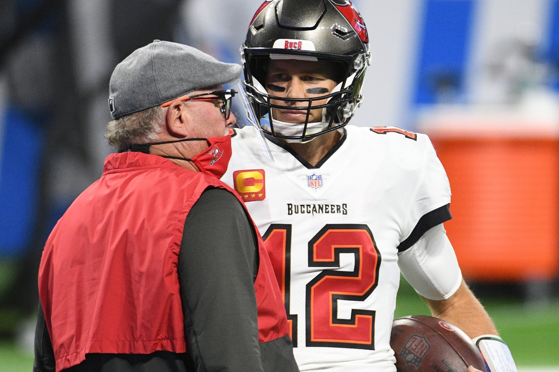 Dec 26, 2020; Detroit, Michigan, USA; Tampa Bay Buccaneers quarterback Tom Brady (12) talks to head coach Bruce Arians before a game against the Detroit Lions at Ford Field. Mandatory Credit: Tim Fuller-USA TODAY Sports