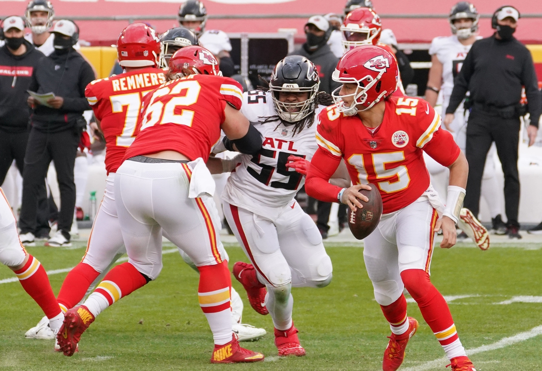 Dec 27, 2020; Kansas City, MO, USA; Kansas City Chiefs quarterback Patrick Mahomes (15) runs the ball against the Atlanta Falcons in the second half at Arrowhead Stadium. Mandatory Credit: Denny Medley-USA TODAY Sports