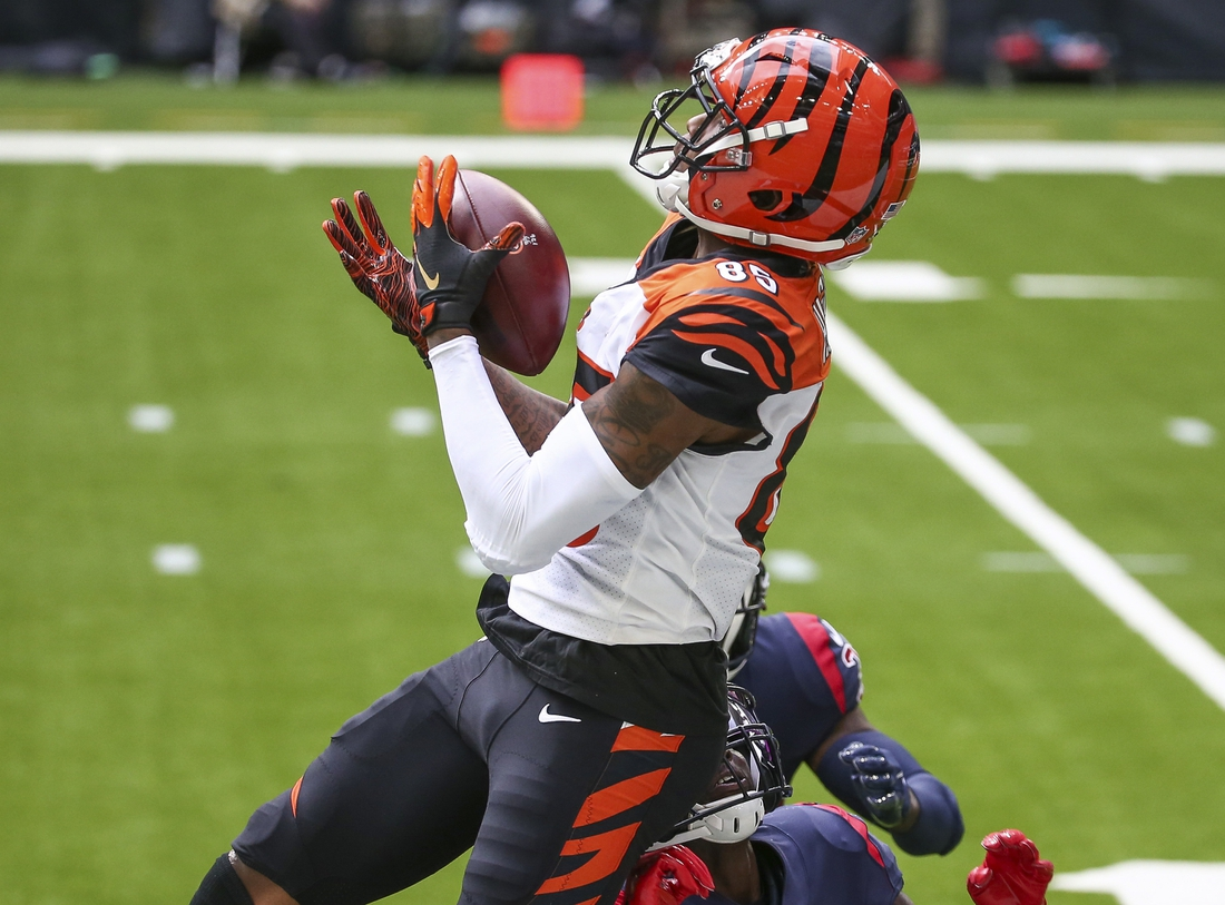 Dec 27, 2020; Houston, Texas, USA; Cincinnati Bengals wide receiver Tee Higgins (85) attempts to make a reception against the Houston Texans during the fourth quarter at NRG Stadium. Mandatory Credit: Troy Taormina-USA TODAY Sports