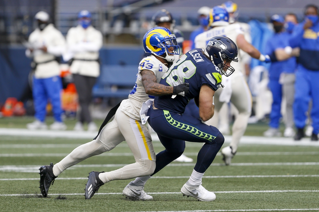 Dec 27, 2020; Seattle, Washington, USA; Seattle Seahawks tight end Greg Olsen (88) is tackled by Los Angeles Rams free safety John Johnson (43) after making a reception during the second quarter at Lumen Field. Mandatory Credit: Joe Nicholson-USA TODAY Sports