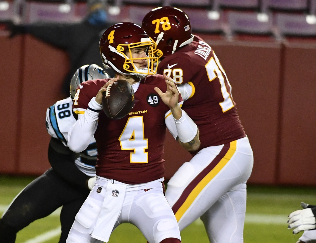 Dec 27, 2020; Landover, Maryland, USA; Washington Football Team quarterback Taylor Heinicke (4) attempts a pass against the Carolina Panthers during the second half at FedExField. Mandatory Credit: Brad Mills-USA TODAY Sports