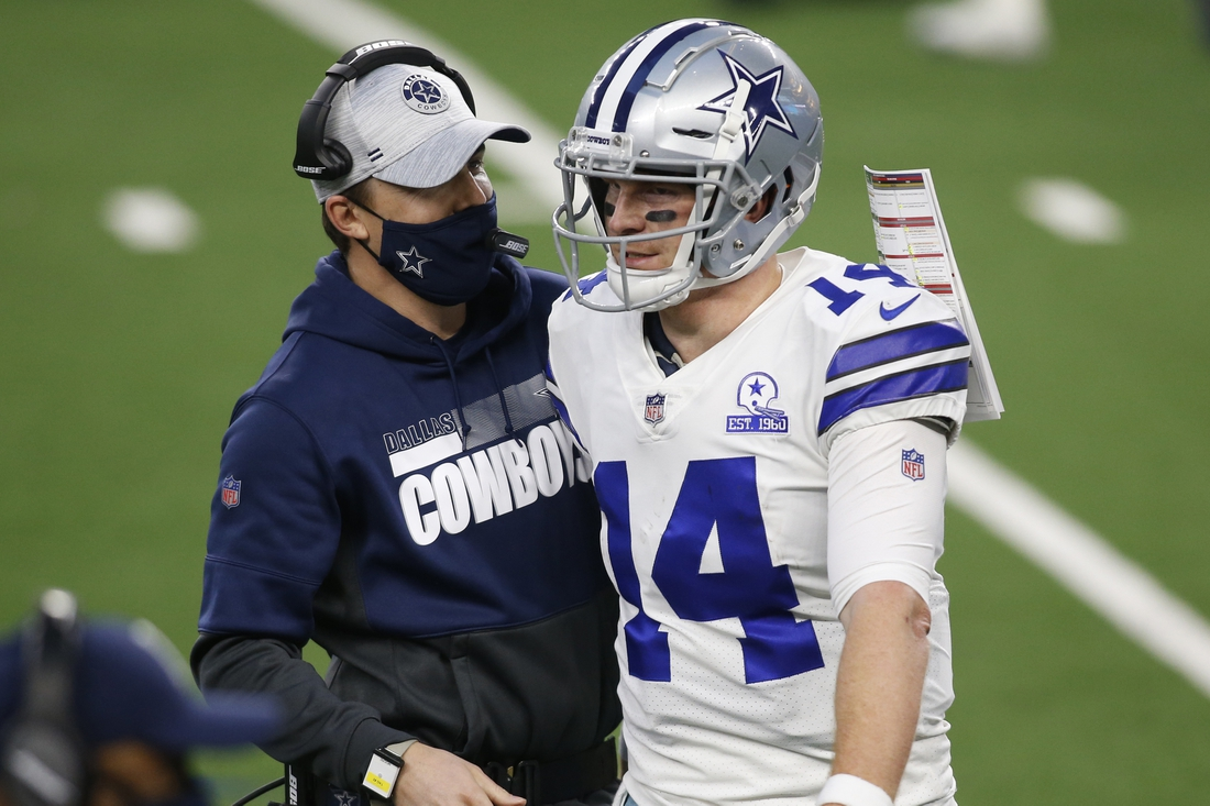 Dec 27, 2020; Arlington, Texas, USA; Dallas Cowboys offensive coordinator Kellen Moore talks with quarterback Andy Dalton (14) after a touchdown in the third quarter against the Philadelphia Eagles at AT&T Stadium. Mandatory Credit: Tim Heitman-USA TODAY Sports