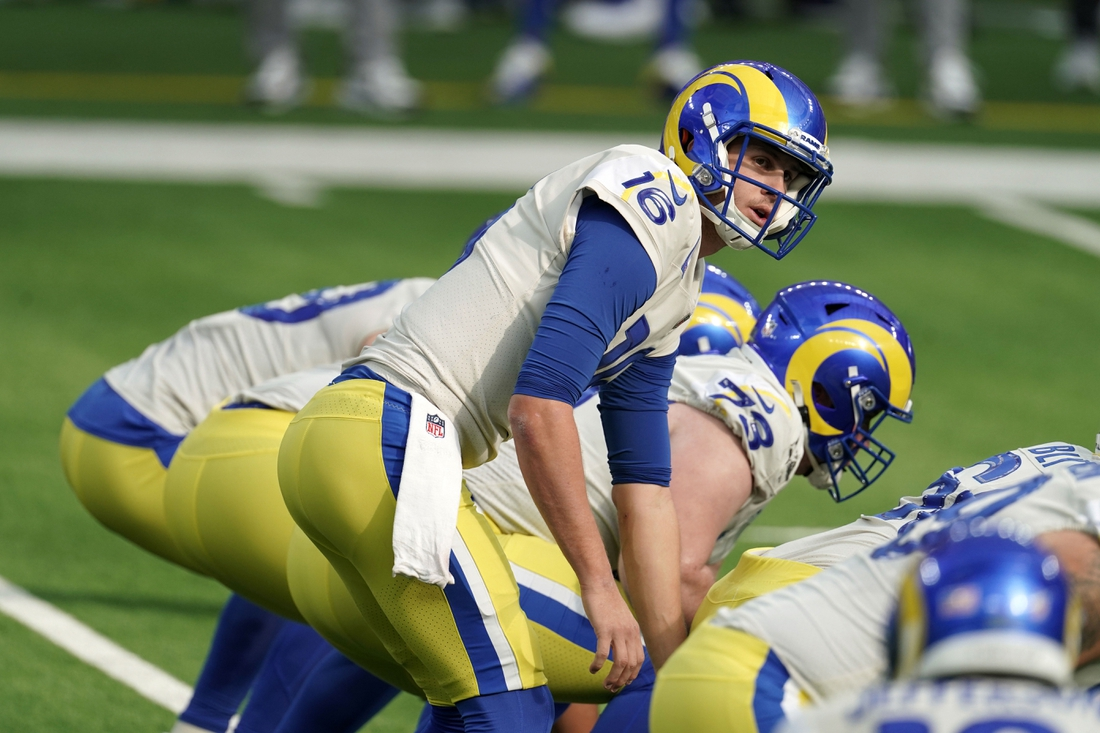 Dec 20, 2020; Inglewood, California, USA; Los Angeles Rams quarterback Jared Goff (16) prepares to take the snap against the New York Jets in the first quarterat SoFi Stadium. The Jets defeated the Rams 23-20. Mandatory Credit: Kirby Lee-USA TODAY Sports