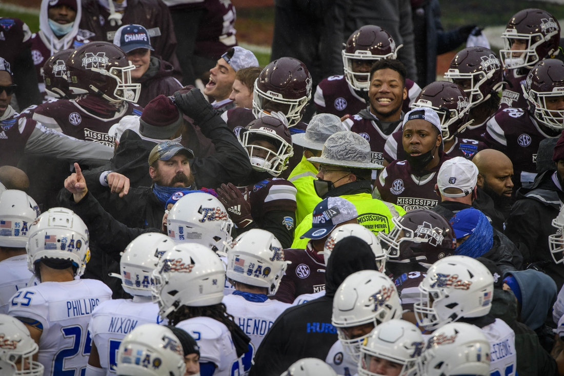 Dec 31, 2020; Fort Worth, TX, USA; The Mississippi State Bulldogs and Tulsa Golden Hurricane teams fight after the game at Amon G. Carter Stadium. Mandatory Credit: Jerome Miron-USA TODAY Sports