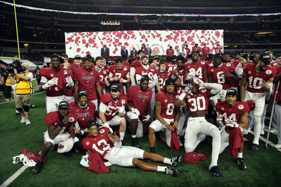 Jan 1, 2021; Arlington, TX, USA;  Alabama Crimson Tide players celebrate the victory against the Notre Dame Fighting Irish at the Rose Bowl at AT&T Stadium. Mandatory Credit: Kevin Jairaj-USA TODAY Sports