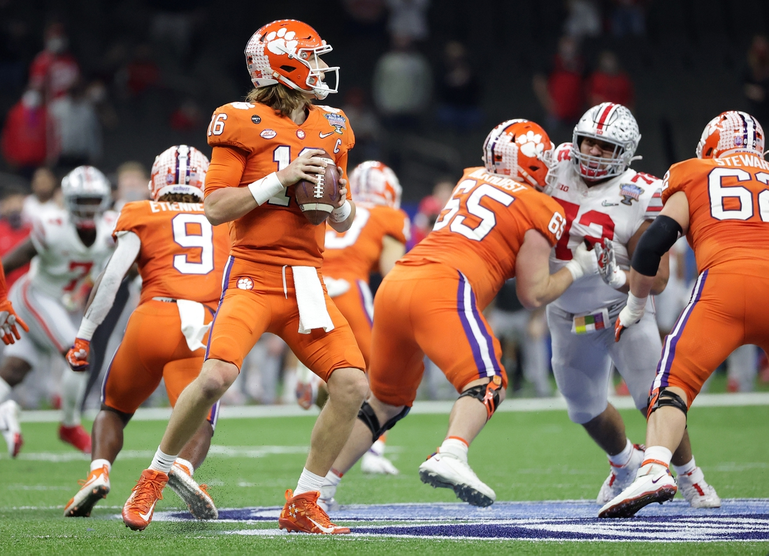 Jan 1, 2021; New Orleans, LA, USA; Clemson Tigers quarterback Trevor Lawrence (16) stands in the pocket with the ball during the first half against the Ohio State Buckeyes at Mercedes-Benz Superdome. Mandatory Credit: Derick E. Hingle-USA TODAY Sports