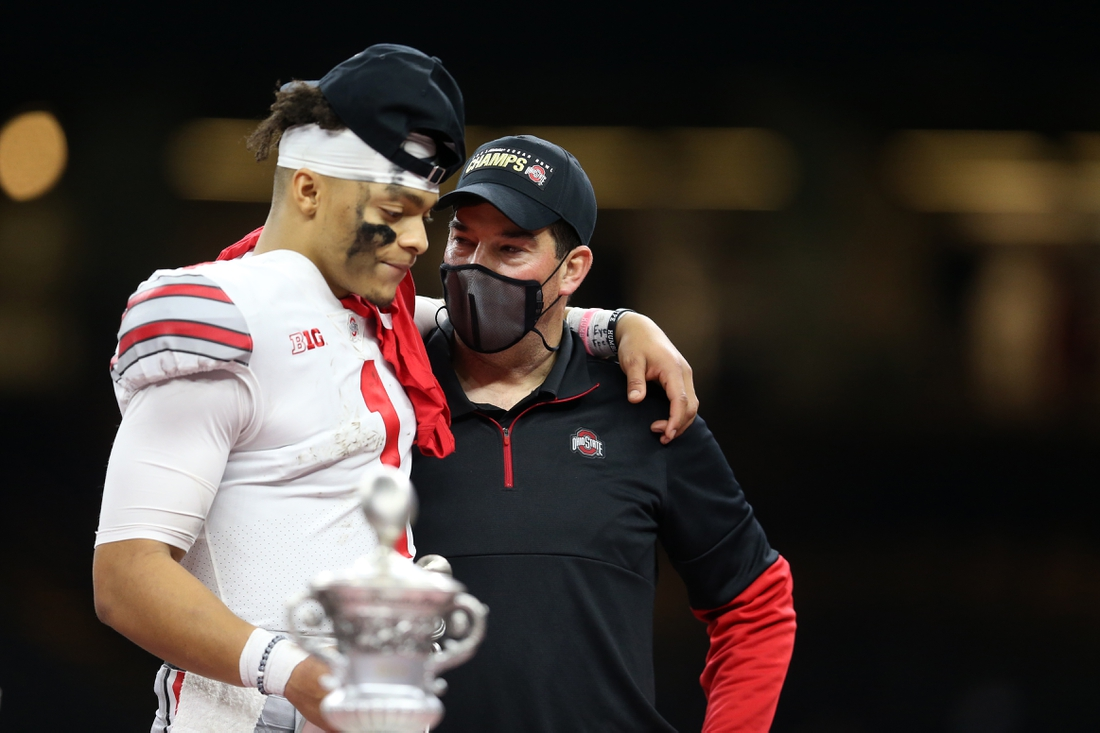 Jan 1, 2021; New Orleans, LA, USA; Ohio State Buckeyes quarterback Justin Fields (1) and head coach Ryan Day celebrate after defeating the Clemson Tigers at Mercedes-Benz Superdome. Mandatory Credit: Chuck Cook-USA TODAY Sports