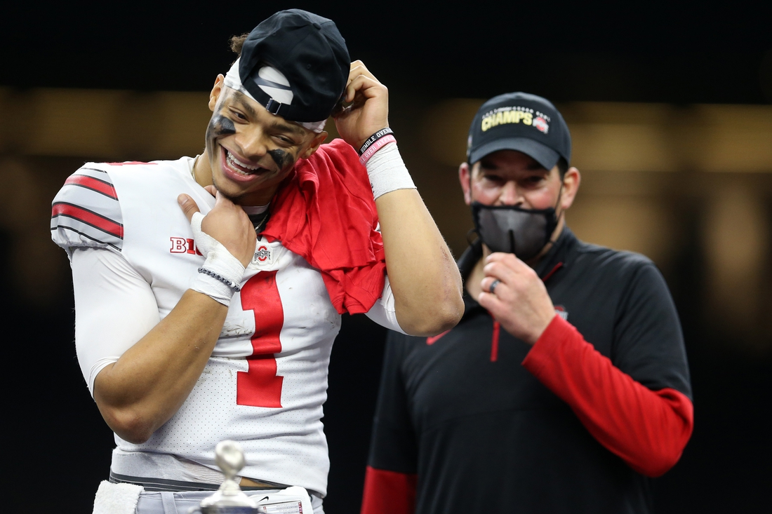 Jan 1, 2021; New Orleans, LA, USA; Ohio State Buckeyes quarterback Justin Fields (1) celebrates with head coach Ryan Day after defeating the Clemson Tigers at Mercedes-Benz Superdome. Mandatory Credit: Chuck Cook-USA TODAY Sports