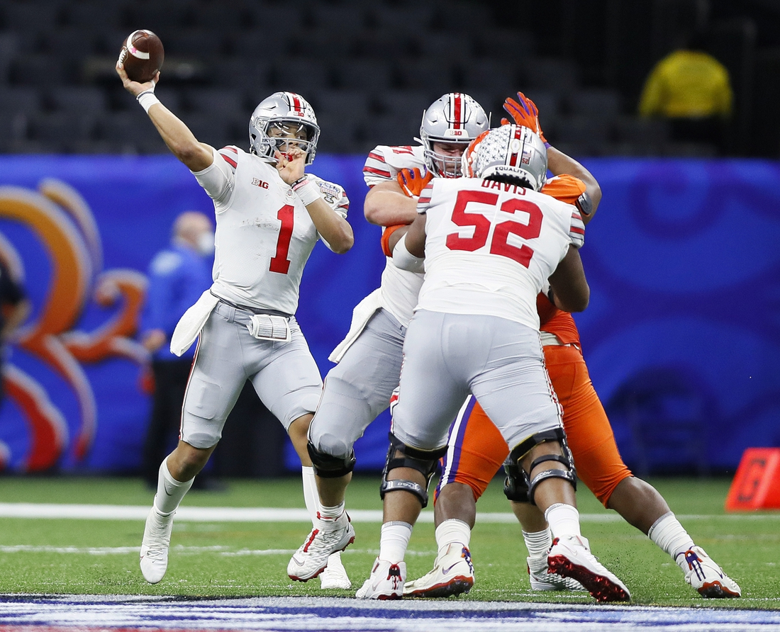 Jan 1, 2021; New Orleans, LA, USA; Ohio State Buckeyes quarterback Justin Fields (1) throws the ball against Clemson Tigers in the third quarter during the College Football Playoff semifinal at the Allstate Sugar Bowl in the Mercedes-Benz Superdome in New Orleans on Friday, Jan. 1, 2021.  Mandatory Credit: Ken Ruinard-USA TODAY Sports