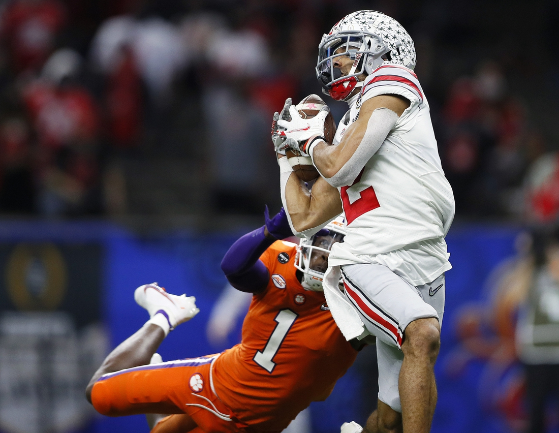 Jan 1, 2021; New Orleans, LA, USA; Ohio State Buckeyes wide receiver Chris Olave (2) makes a touchdown catch against Clemson Tigers cornerback Derion Kendrick (1) in the third quarter during the College Football Playoff semifinal at the Allstate Sugar Bowl in the Mercedes-Benz Superdome in New Orleans on Friday, Jan. 1, 2021.  Mandatory Credit: Ken Ruinard-USA TODAY Sports