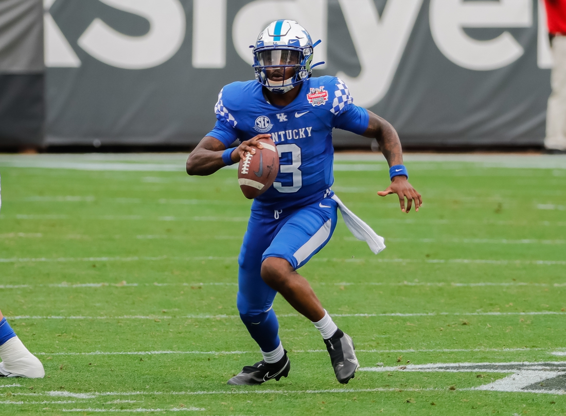 Jan 2, 2021; Jacksonville, FL, USA; Kentucky Wildcats quarterback Terry Wilson (3) carries the ball against the North Carolina State Wolfpack during the second half at TIAA Bank Field. Mandatory Credit: Mike Watters-USA TODAY Sports